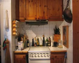 A close up of the kitchen - before: rustic Kitchen by Cathy Phillips & Co