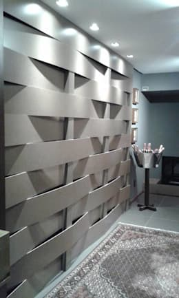 Treliça em porcelanato: Casa  por Interior Design Christiano Carvalho