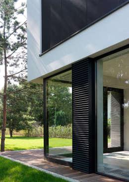 Dom175: styl minimalistyczne, w kategorii Domy zaprojektowany przez Jednacz Architekci