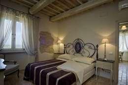 Habitaciones de estilo rústico por Roberto Catalini  Int. Designer