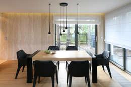 Jadalnia z widokiem na ogród: styl , w kategorii Jadalnia zaprojektowany przez living box