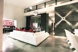 Salas / recibidores de estilo moderno por Diez y Nueve Grados Arquitectos