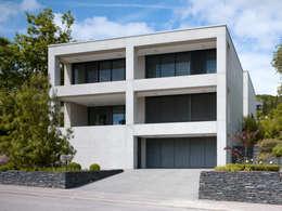 Projekty, minimalistyczne Domy zaprojektowane przez PaulBretz Architectes