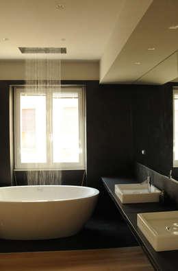 Baños de estilo moderno por km 429 architettura