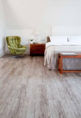 Paredes y suelos de estilo  por Granorte