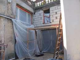 Rénovation d'un garage en agence d'architecture:  de style  par Atelier d'Architecture du Golfe