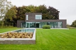 Projekty, nowoczesne Domy zaprojektowane przez hasa architecten bvba
