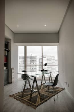 Departamento GC: Estudios y oficinas de estilo moderno por kababie arquitectos