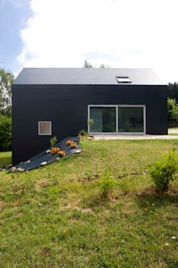 maison nd maisons de style de style moderne par atelier darchitecture geoffrey nol - Implantation Maison Sur Terrain En Pente