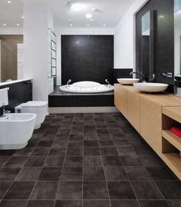 Paredes y pisos de estilo moderno por PAVIMENTOS GERFLOR