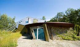 Dom Własny : styl nowoczesne, w kategorii Domy zaprojektowany przez autorskie studio architektury