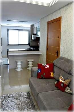 Salas de estilo moderno por Tuti Arquitetura