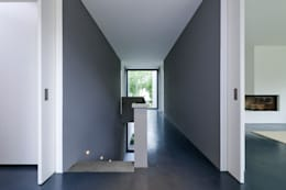 Projekty,  Korytarz, przedpokój zaprojektowane przez Architekturbüro Dongus
