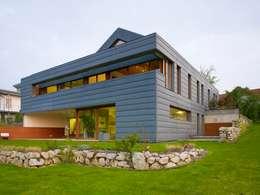 Projekty, nowoczesne Domy zaprojektowane przez PAPTISTELLA architekten gmbh
