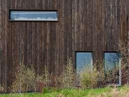 Dom w Burowie: styl wiejskie, w kategorii Domy zaprojektowany przez WIZJA