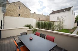 en coeur d'ilôt: Terrasse de style  par agence MGA architecte DPLG
