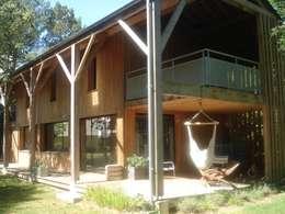 maison NEV: Terrasse de style  par Cécile Boerlen Architecte SARL