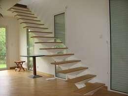 Extension Maison à Sucé-Sur-Erdre: Salon de style de style Minimaliste par SERAIN-LOUKAKOU ARCHITECTEURS