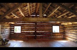 Casas rústicas por Studio Moretti