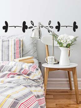 Dormitorios de estilo moderno por Petit Vinilo