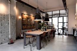 industrial Dining room by BRICKS Studio