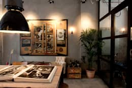 Garage Loft: eclectische Eetkamer door BRICKS Studio