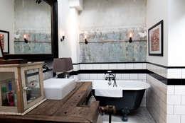 Baños de estilo industrial por BRICKS Studio