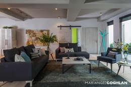 Salas de estilo industrial por MARIANGEL COGHLAN