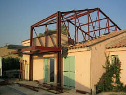 L'ossature métallique indépendante de l'existant: Maisons de style de style Moderne par scp bastide gaucher