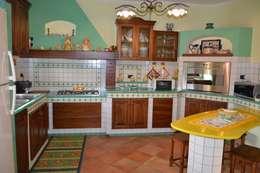 Cocinas de estilo rústico por Fazzone camini