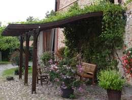 Porches y Pérgolas adosados: Casas de estilo moderno de JAGRAM-PRO