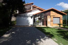Projekty, wiejskie Domy zaprojektowane przez Mutabile