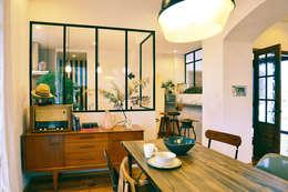 ミッドセンチュリー家具の映えるダイニング: パパママハウス株式会社が手掛けたダイニングです。