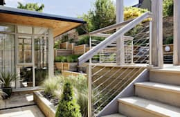Steeply sloping garden with decked terraces:   by Susan Dunstall Landscape & Garden Design