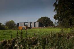 Projekty, nowoczesne Domy zaprojektowane przez Patrick Bradley Architects