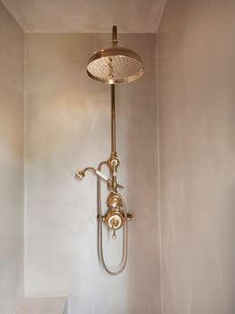 Baños de estilo minimalista por Drummonds Bathrooms