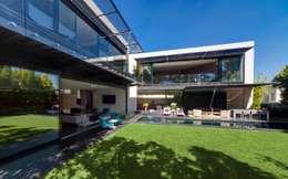 Jardin de style de style Minimaliste par grupoarquitectura