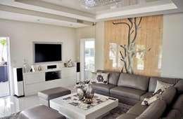 Dom w Amarantusach : styl , w kategorii Salon zaprojektowany przez Abakon sp. z o.o. spółka komandytowa