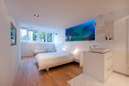 Modern interieur Amsterdam oud-zuid: moderne Slaapkamer door Het Ontwerphuis