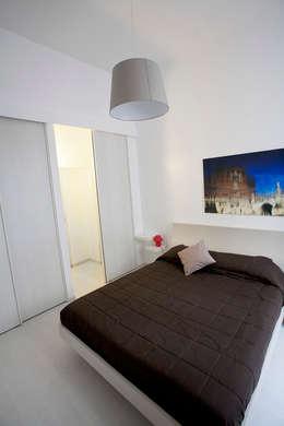 Habitaciones de estilo minimalista por Pamela Tranquilli