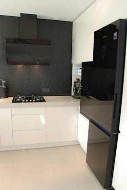 DOM NOWOCZESNY: styl , w kategorii Kuchnia zaprojektowany przez YNOX Architektura Wnętrz