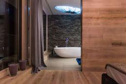 Salle de bains de style  par ARKITURA GmbH