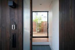 猫と暮らす中庭のある家: 設計事務所アーキプレイスが手掛けた家です。