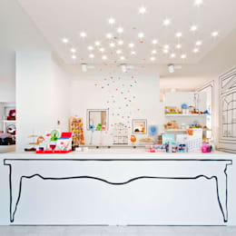 Oficinas y tiendas de estilo  por Dipiù Studio