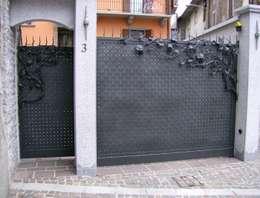 Casas de estilo  por CMG Costruzioni Metalliche Grassi
