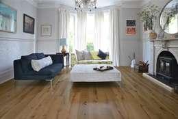 Paredes y suelos de estilo  por The Natural Wood Floor Company