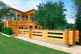 Projekty, nowoczesne Domy zaprojektowane przez Woody-Holzhaus - Kontio