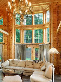 Salas de estar modernas por Woody-Holzhaus - Kontio