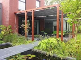 Jardines de estilo moderno por Bladgoud-tuinen