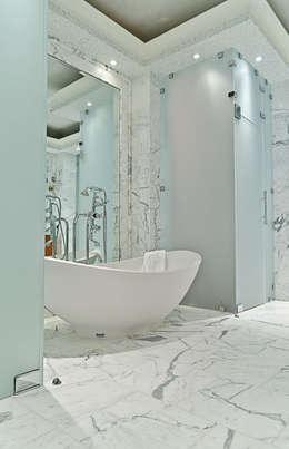 Baños de estilo minimalista de Oikos Design